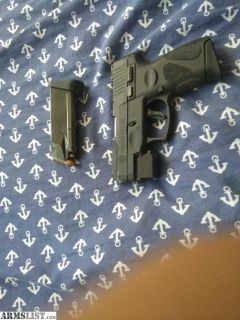 For Sale: Taurus millennium G2 with laser and two mags