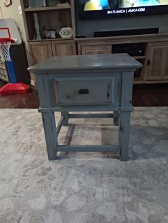 """Rustic blue/gray end table with drawer. 25"""" tall x 24"""" long x 24"""" deep."""