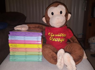 Curious George backpack and 27 books
