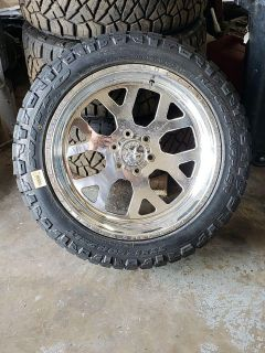 American Force wheels 22 X 10 and Nitto Ridge Grappler tires 33 X 12.5