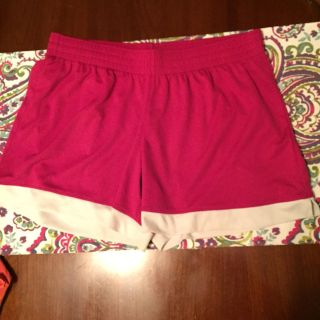 Dark pink without shorts. Sz L