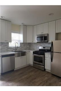 1 bedroom Apartment - MACARTHUR PARK recently remodeled exhibiting new hardwood floors.