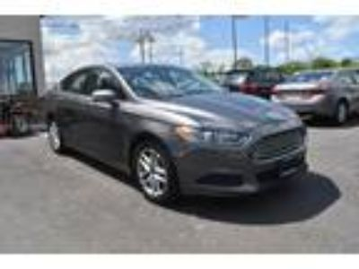 2014 FORD Fusion with 90499 miles!