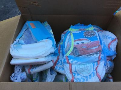 23 Pull ups and 2 swim diapers Size 4-5T