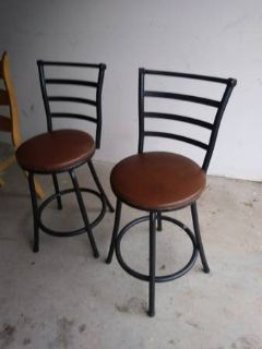2 black metal back swivel padded bar stools In Fairfield on Saturday 6/16 if you want me to brin...