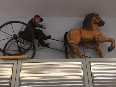 Man on Sulky Horse.