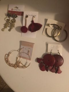 Brand new earrings In the packages. Over 200 pairs