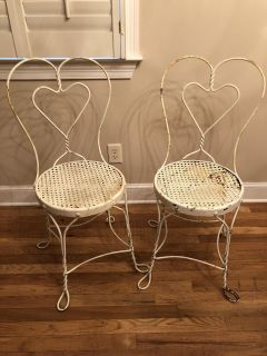 Two rod iron outdoor chairs