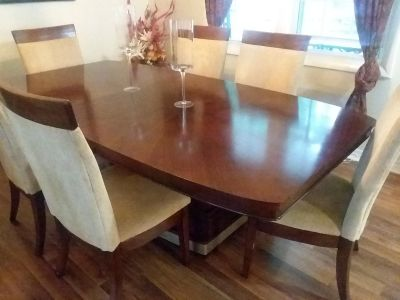 Rectangle brown wooden kitchen table with 4+ chairs