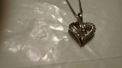 Pure Gold with Real Diamonds pennant heart only pd over $400