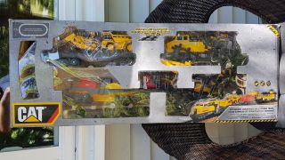 CAT Construction Express Train Set in very good used condition, with box, retails $201.91 at WalMart. Price $25