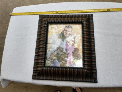 Plastic metal looking picture frame never used.
