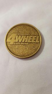"""Commemorative Petersen's 4 Wheel and Off-Road Classic Collector's Series """"Rockin"""" coin."""