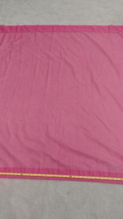 2 panels of sheer pink curtains