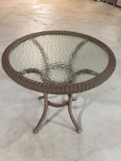 Glass and plastic rattan over steel frame patio table