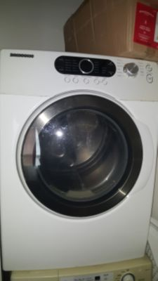Front loading washer and dryer w/stands. PLEASE READ DESCRIPTION