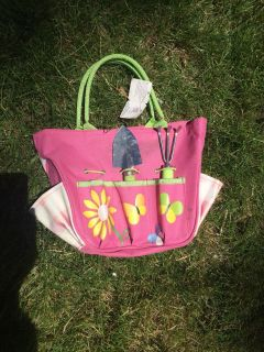 Little kid gardening bag and tools