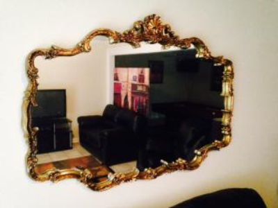 $100, Very Large Antique Mirror trimed in gold...$100