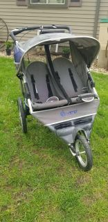 Instep double jogging stroller! Needs new back tire!! FIRST COME! MACKINAW PICKUP TODAY