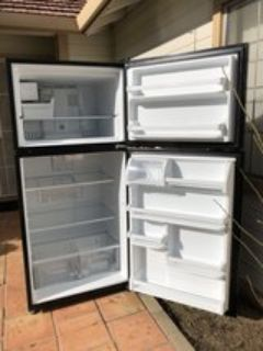 Moving must sell today Like New Whirlpool Refrigerator