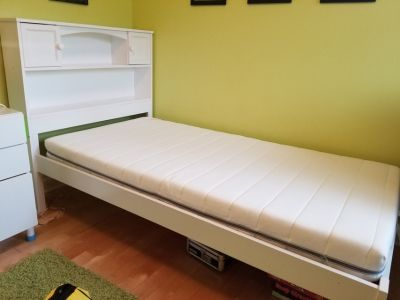 Twin bed with shelves/ cabinets headboard
