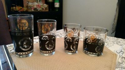 60 Continental Coin Company Glasses. vintage, good condition, with gold logos
