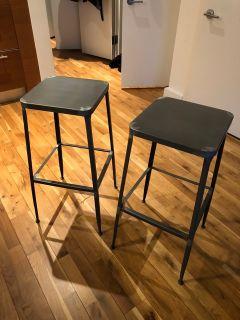 Pair of CB2 steel bar stools