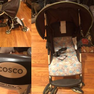 Baby Stroller Cosco Compact/Light Weight. Color Brown