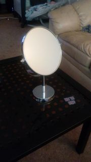 Double sided makeup mirror