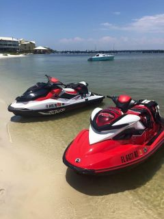 2 SeaDoos with trailer, 2 fitted SeaDoo covers, 6 vests, and pull behind float