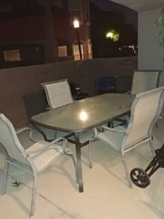 A bunch of outdoor furniture