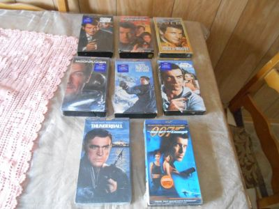 (7) JAMES BOND 007 VHS Movies Plus 1 Roger Moore VHS Movie! Lot of 8 VHS tapes