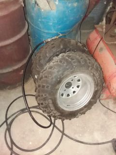 4 wheeler tires and one rim