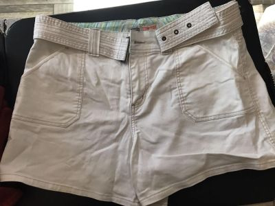 White size 14 shorts with removable belt. One small spot on the back pocket excellent condition otherwise