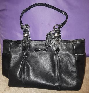 $12 Firm Black Coach Euc outside inside needs some cleaning