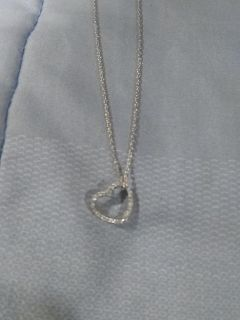 Silver necklace and floating heart