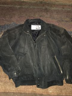 Black leather jacket. Size M. Unisex for motorcycle riding. Picture looks faded but jacket is not. Nylon lined. Heavy. PPU only.