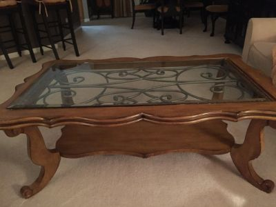 Solid wood and iron coffee table, glass top
