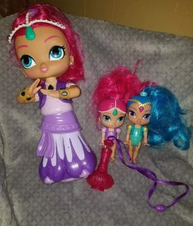 Shimmer and shine. Big doll talks and responds to commands made by pushing top of genie bottle necklace $20