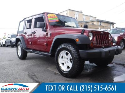 2009 Jeep Wrangler Unlimited X (Red Rock Crystal Pearl)