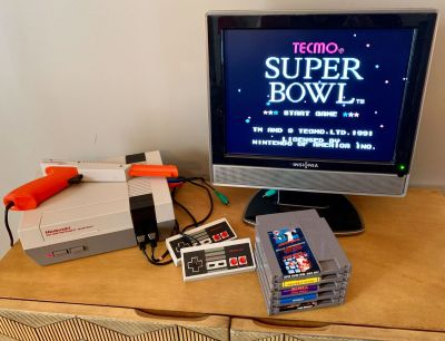 Original Nintendo NES with games, two controllers, and Zapper