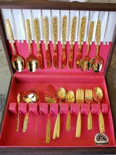 Vintage gold plated flatware set in wood box.