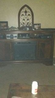Ashley TV stand. with electric fireplace insert