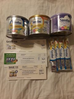 New cans of Similac powder baby formula and checks. Free Gerber food pouch coupon
