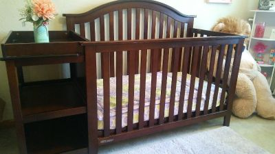Crib with attached changing table/shelving