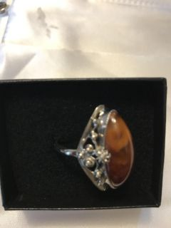 Amber stone set in sterling silver setting.