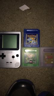 Game boy pocket and three games