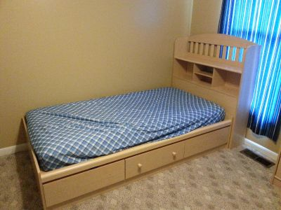 Set of twin beds with two tall dressers.