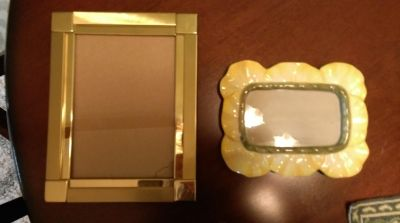 2 nice brass and porcelain picture frames