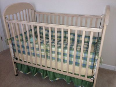 Crib complete with mattress, bumper set.